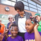 Mayor Rawlings-Blake and children at the opening of the Morrell Park Community Center